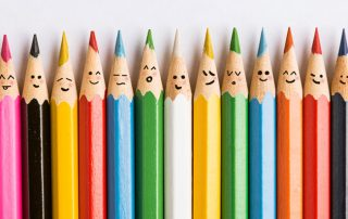 row of colored pencils representing inclusion in the work place