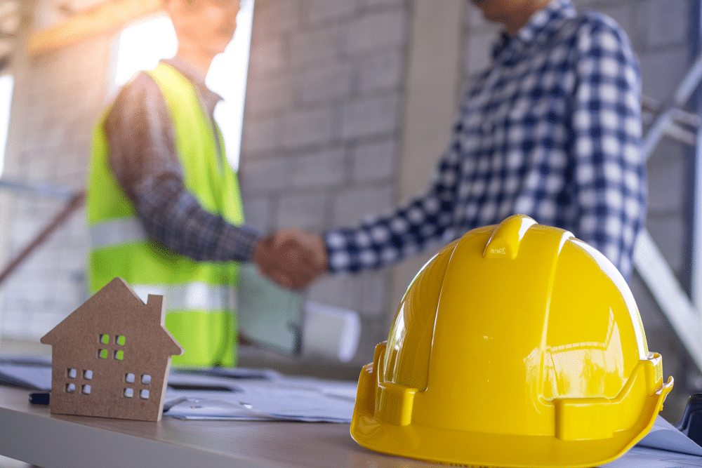 Building owner shaking hands with a contractor